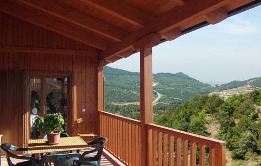 terraza exterior casa de madera prefabricada Vilas Anderson